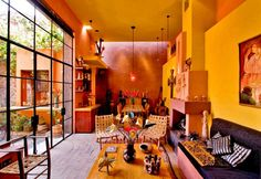 Mexican Living Room With Yellow Walls And Unique Accessories : Colorful And Charming Mexican Interior Design
