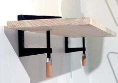 super cool wall clamps for a shelf!