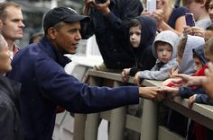 U.S. President Barack Obama shakes hands with onlookers in front of Nancy's Restaurant before placing a take-out order August 13, 2013 in Oak Bluffs, Massachusetts. President Obama and his family are spending the week on the island for their summer vacation. (August 12, 2013 - Source: Pool/Getty Images North America)
