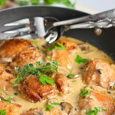 Creamy Chicken and Mushroom Skillet Recipe Main Dishes with boneless chicken skinless thigh, flour, butter, olive oil, sliced mushrooms, garlic, white wine, chopped fresh thyme, asiago, dijon mustard, cream