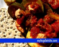 Chicken Zucchini Bake -  1lb. chicken breast, cubed  1 med. onion, diced  8c. zucchini, sliced  1 clove garlic, minced 1(14oz.) can diced tomatoes 1(8oz.) can tomato sauce  1t. Italian seasoning 1⁄2c. water  Salt and pepper to taste