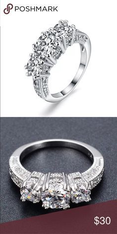 COMING SOON Stunning white gold plated ring with white crystals. Size 6 Jewelry Rings