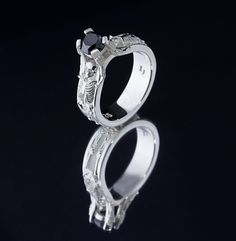 Our famous skeleton engagement ring with a black diamond center -Images Jewelers