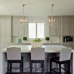 light taupe kitchen cabinets, cream countertops,  cream marble countertops, cream marble subway tiles.