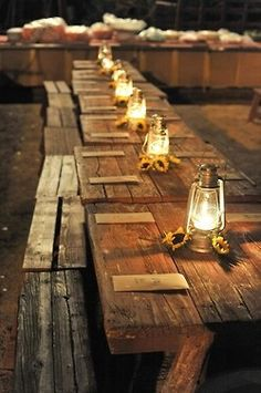 """Rustic """"picnic tables"""" with lanterns, wool plaid and vintage style textiles, ferns, and feathers to be used for crafting and  lounging. Tables and benches sourced at Salt Lake City's RSVP Party Rentals."""