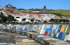 Horta, Faial - Azore Islands.     All sailboats, while sailing around the globe, stop here and paint their country's flag.
