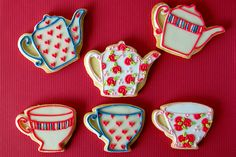 """Teapot and cup cookies decorated beautifully by the """"Mad Baker""""."""