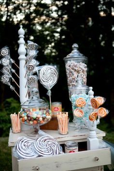 gorgeous & creative candy buffet. Love the lollipop stand in the back.