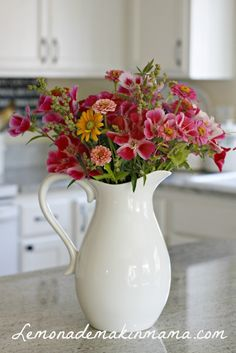 Image result for white farmhouse pitcher with red flowers on countertop