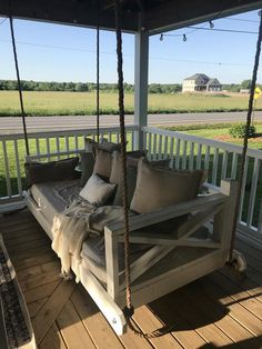 35 Rethink Your Outdoor Space by Channeling This Dreamy Porch Swing Outdoor Living Outdoor porch swings are a classic accent on the porch of a . Bed Swing, Farmhouse Front Porches, Porch Swing Bed, Diy Porch Swing, House With Porch, Front Porch Decorating, Diy Porch, Porch Bed, Porch Swing