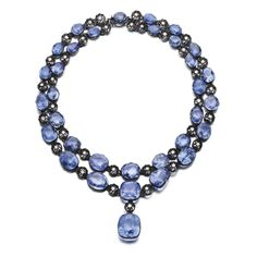 Sapphire and diamond necklace Designed as two rows of oval and cushion-shaped sapphires alternating with floral motifs highlighted with brilliant-cut diamonds, the front supporting a pendant set with a cushion-shaped sapphire, length approximately 335mm.