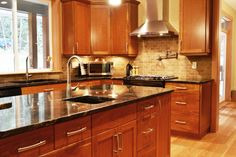 Cherry cabinets, light wood floor with light countertops. Description from pinterest.com. I searched for this on bing.com/images