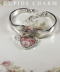 Silver spoon bracelet with broken china charm