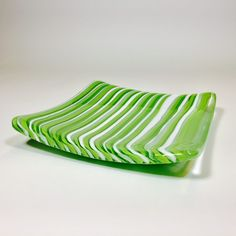 Amazon Platter    This amazon green and white platter, both decorative and functional was created by cutting thin pieces of glass and fitting them together, on edge, in this pattern.