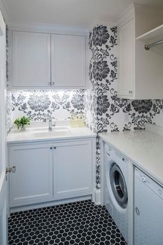 Black+and+white+laundry+room+features+walls+clad+in+black+and+white+damask+wallpaper+lined+with+...