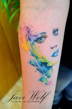 Watercolor face tattoo. Tattooed by @Javi Wolf