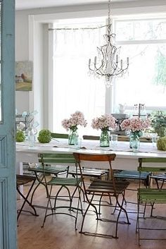 Shabby chic dining room with chandelier & hydrangeas