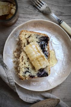 blueberry muffin loaf with cut comb honey.