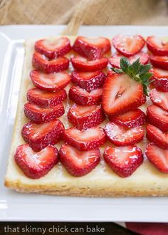 Strawberry Cheesecake Bars | A shortbread cookie crust topped with a thinl layer of cheesecake and juicy sliced berries