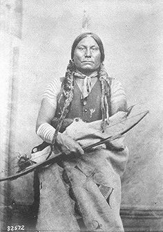 Gall (Pizi, Gaul), a Hunkpapa Sioux; three-quarter- length, seated. holding bow and arrow, Fort Buford, North Dakota.  Photographed by David F. Barry, 1881.