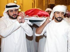 Crown Prince of Dubai Sheikh Hamdan bin Mohammed (right) and the emirate's deputy ruler Sheikh Maktoum bin Mohammed, carry the body of their late brother Sheikh Rashid