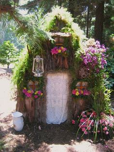 A rustic and pretty fairy house with a cute little lantern to boot.