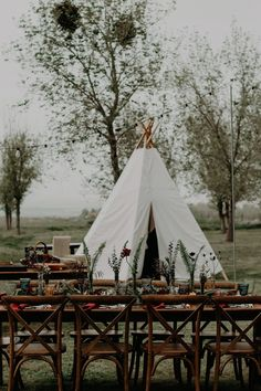 That hand-made tent was not only the perfect shelter for the bride to get ready, but it also makes a cute reception backdrop in this Wind Wolves Preserve | Image by Rubi Z Photography