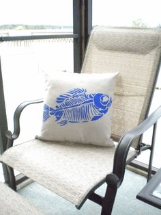 canvas pillow with fish fossil stencil by necessarynuisance, $20.00