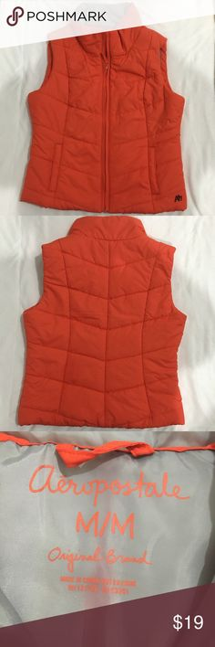 Aeropostale Orange Chevron Puffer Vest NWOT NWOT and in excellent condition! This is the perfect vest for Fall and Winter. Not too heavy or bulky.  Bright orange outside. Gray inside. Two side pockets. Full zip up front. Medium size but runs small. Aeropostale Jackets & Coats Vests