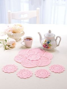 The pieces in this pretty ensemble can be used together as a teatime set or individually as a separate doily and coasters. Designs are made with size 10 crochet cotton thread and size steel hook. Size: Doily: in diameter. Annie's Crochet, Crochet Tools, Crochet Doll Pattern, Crochet Crafts, Crochet Doilies, Crochet Patterns, Crochet Projects, Crochet Doll Clothes, Doll Clothes Patterns