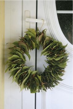 Bay Leaf Wreath, all you need is a wire hanger and leaves from your yard. All Things Christmas, Christmas Crafts, Christmas Decorations, Holiday Decor, Diy Wreath, Door Wreaths, Advent Wreath, Diy Couronne Noel, Navidad Natural