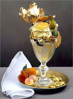 """Golden Opulence Sundae most expensive food- This Sundae includes a edible gold leaf, rare chocolates and ice cream, served in a crystal goblet with an gold spoon. It also holds the Guinness World Record for """"Most Expensive Sundae. Most Expensive Ice Cream, Most Expensive Food, Expensive Cars, Chocolate Caro, Chocolate Truffles, Chocolate Syrup, Haute Chocolate, Frozen Chocolate, Chocolate Covered"""