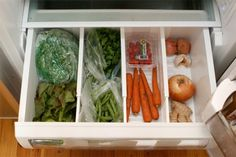 Use dividers in the refrigerator vegetable bin to separate onions from carrots, etc