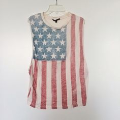 """  ✨HP✨ Truly Madly Deeply Flag Muscle Tank A comfy American flag tank, perfect for summer (and July 4th!), fits XS-M for an oversized fit, new with tags.                                                                             ✨ """"Summer Essentials"""" Host Pick 6/14/15 Urban Outfitters Tops Tank Tops"""