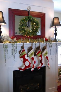 Christmas mantle with mirror, wreath, lamps