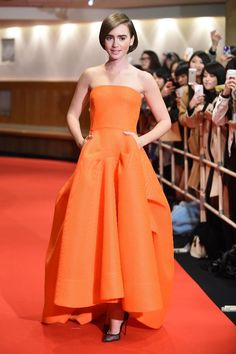 In Tokyo,  Collins wore a vibrant orange gown by Maticevski to the premiere of her new film, Rosie.