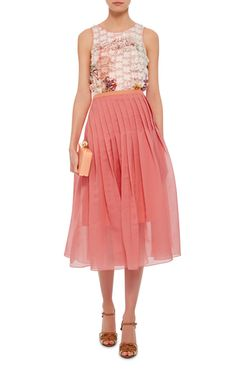 Crafted in a bright watermelon-hued organza, this **Tibi** skirt features a high rise with knife pleats around the hips and a ladylike midi-length hem.
