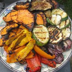 Roasted Vegetable Medley: 2 tablespoons olive oil divided, 1 large yam peeled and cut into 1 inch pieces, 1 large parsnip peeled and cut into 1 inch pieces, 1 cup baby carrots, 1 zucchini cut into 1 inch slices, 1 bunch fresh asparagus trimmed and cut into 1 inch pieces, 1/2 cup roasted red peppers cut into 1-inch pieces, 2 cloves garlic minced, 1/4 cup chopped fresh basil, 1/2 teaspoon kosher salt, 1/2 teaspoon ground black pepper