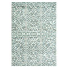 Lend a pop of pattern to the den or master suite with this stylish rug, showcasing a medallion motif in alpine and cream.   Product:...