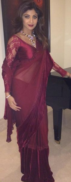 Shilpa Shetty in gorgeous purplish-maroon Manish Malhotra saree. Such a sexy color!