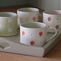 Set of four straight mugs in designs chosen by Susie £58