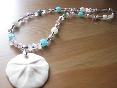 Sand Dollar Necklace with Pink, Green, and Blue