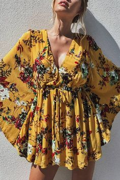The perfect dress has arrived! This floral dress features a lovely light weight fabrication,deep V neckline, cross front detailing and large bell sleeves. Style with high heels and you are set for a winters day! Yellow Lace Dresses, Cute Dresses, Casual Dresses, Dresses With Sleeves, Summer Dresses, Short Dresses, Boho Fashion, Fashion Dresses, Womens Fashion