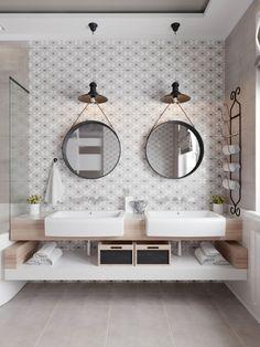 Wysoką łazienkę urządzono na zasadzie symetrii. Na głównej ścianie znajdują się dwie umywalki i dwa okrągłe lustra nad...