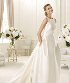 vendo vestido de novia, nuevo con etiqueta, sin estrenar, de pronovia, del diseñador Manuel Mota, en concreto el modelo Galaica, tejido mikado, talla 42, sin areglar de nada, ni bajo