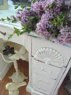 Love the lilacs with the beautiful shabby white desk!
