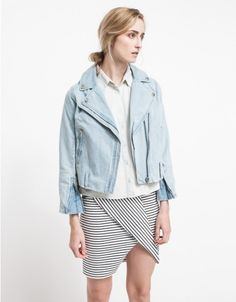 From Cheap Monday, a denim moto jacket with classic style. Features a notched lapel, asymmetrical front zipper closure, zipper detailing at the cuffs, belt loops and a straight fit through the torso.  •Denim moto jacket •Notched lapel •Asymmetri