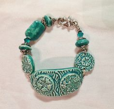 Ceramic bracelet with sterling silver,  by Sheri Mallery  SlinginMud.etsy.com