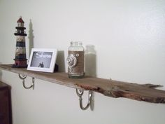 Old fence wood that I re-purposed into a rustic beachy looking shelf