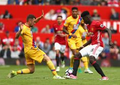 James McArthur of Crystal Palace and Axel Tuanzebe of Manchester United battle for the ball during the Premier League match between Manchester United...